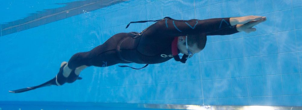 Freediver with monofin in the pool